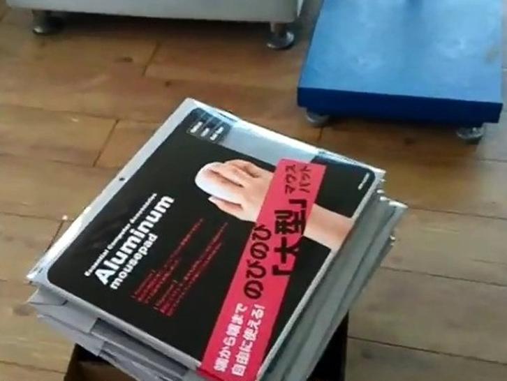 QC inspectors test aluminum mouse pad